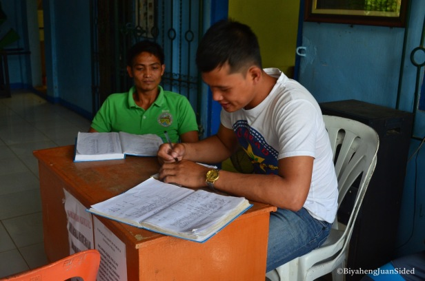 one of the barangay officials that take care of the registration of the visitors