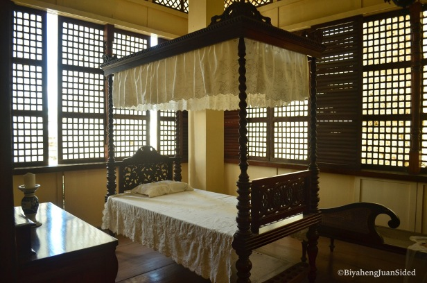 an old bed, replica of the beds used during the time of Dr. Jose Rizal