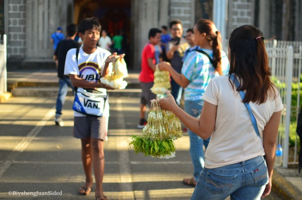 a line of Sampaguita vendors at the Parish Church beside the shrine