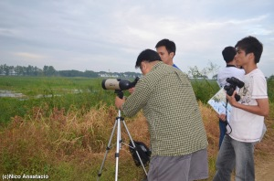 A professor and his students viewing the migratpry birds in Candaba Swamp.