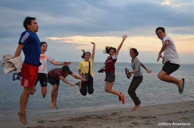 Golden sunset  serving as a beautiful backdrop for a jumpshot of friends.
