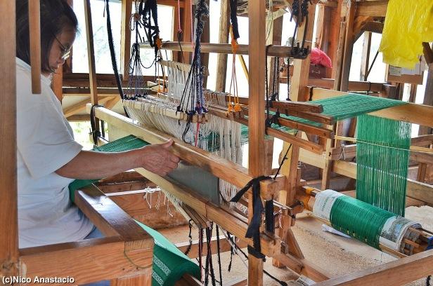 a local weaving a cloth