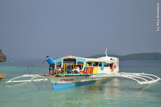 Boat full of tourists who will visit the Bitaog Beach