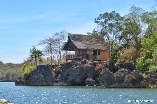 A Nipa Hut on a rock formation