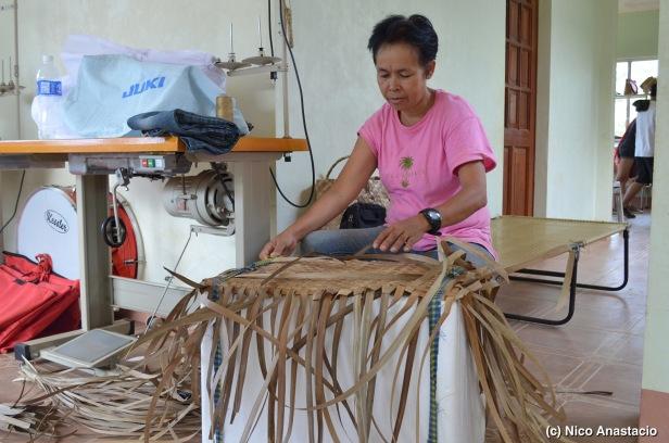 Weaving a native mat