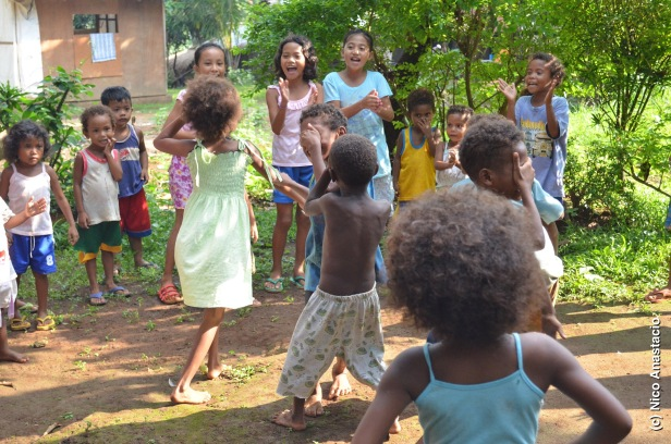 Children playing  with their visitors