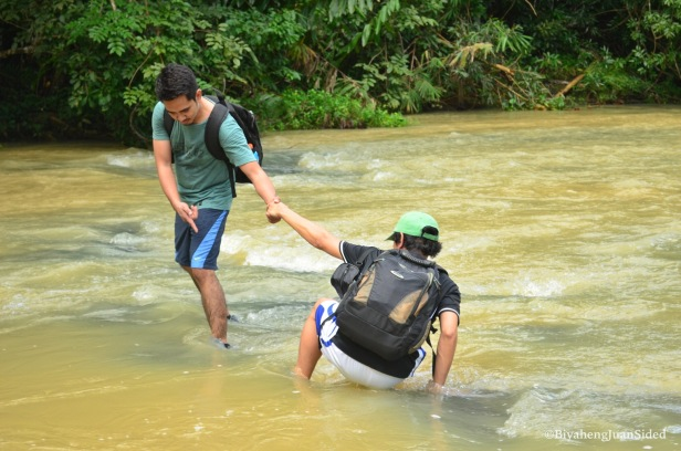our friend Marion helping Patrick cross the river